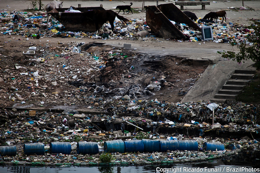 Guanabara bay pollution, large amount of garbage at the mouth of Timbo river where it meets the waters of Guanabara Bay, beside Favela da Mare - the eco-barrier is not able to stop junk from reaching the bay.