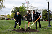 U.S. President Donald Trump with France's president Emmanuel Macron and First Ladies Melania Trump and Brigitte Macron (not pictured) plant a tree, a gift from the President and Mrs. Macron, on the South Lawn of the White House in Washington, D.C., U.S., on Monday, April 23, 2018. As Macron arrives for the first state visit of Trump's presidency, the U.S. leader is threatening to upend the global trading system with tariffs on China, maybe Europe too. <br /> Credit: Yuri Gripas / Pool via CNP