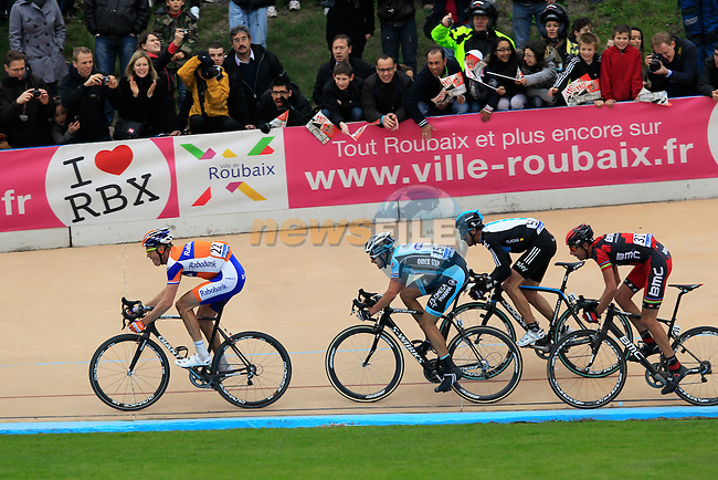 The chasing pack led by Lars Boom (NED) Rabobank with Niki Terpstra (NED) Omega Pharma-Quickstep, Juan Antonio Flecha Giannoni (ESP) Sky Procycling and Alessandro Ballan (ITA) BMC Racing behind head for the line in the Roubaix Velodrome at the end of the 110th edition of the Paris-Roubaix spring classic cycle race. 8th April 2012 (Photo by Eoin Clarke 2012)