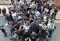 Media crowd around White Nationalist Matthew Heinbach who blamed city and law enforcement officials for Saturday's violence outside Charlottesville District Court where James Alex Fields Jr., 20, of Maumee, Ohio, was arraigned on Monday. Photo/Andrew Shurtleff