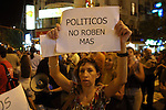 "Alejandra Palacios, 43, , holds a sign calling ""politicians stop robbing"" as she demonstrates in Buenos Aires, January 9,2002. Hundreds of Argentineans went to the streets to demonstrate banging pots and stopping the traffic in major streets in the capital, few minutes after the new Economy minister Jorge Lenicov addressed the nation, with new economy decisions. Photo by Quique Kierszenbaum"