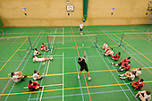 Badminton session in the sports hall at Barking Abbey School, London