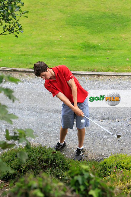 Garreth Carr (Mullingar) on the 1st ends up in a bush during Round 1 of the Grange Dublin Boys on Monday 21th July 2014.<br /> Picture:  Thos Caffrey / www.golffile.ie