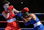 Nico Hernandez, left, and Leroy Davila compete in the U.S. Olympic Boxing Trials in Reno, Nev., on Wednesday, Dec. 9, 2015. (AP Photo/Cathleen Allison)