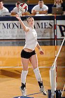 20 November 2008:  New Orleans middle blocker Kaley Hubbard (4) hits a kill shot during the New Orleans 3-1 victory over UALR in the first round of the Sun Belt Conference Championship tournament at FIU Stadium in Miami, Florida.