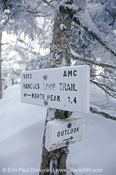 Trail sign along the Hancock Loop Trail in the White Mountains of New Hampshire during the winter months.