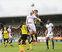 Bolton Wanderers Mark Beevers jumps with Burton Albion's Kyle McFadzean<br /> <br /> Photographer Mick Walker/CameraSport<br /> <br /> The EFL Sky Bet Championship - Burton Albion v Bolton Wanderers - Saturday 28th April 2018 - Pirelli Stadium - Burton upon Trent<br /> <br /> World Copyright &copy; 2018 CameraSport. All rights reserved. 43 Linden Ave. Countesthorpe. Leicester. England. LE8 5PG - Tel: +44 (0) 116 277 4147 - admin@camerasport.com - www.camerasport.com