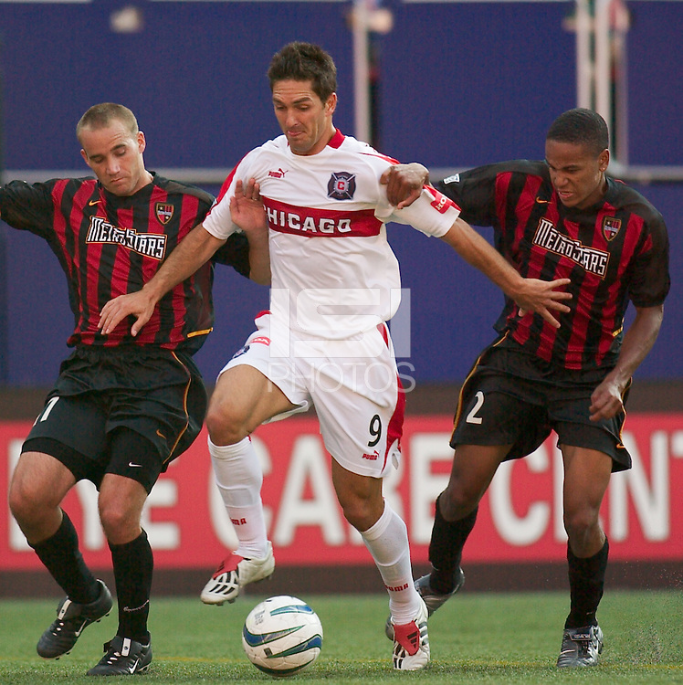 Ante Razov of the Fire is double teamed by Joey DiGiamarino and Ricardo Clark of the MetroStars. The Chicago Fire defeated the NY/NJ MetroStars 2-1 on 8/24/03 at Giant's Stadium, NJ..