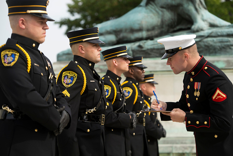 UNITED STATES - MAY 14: Marine Lance Cpl. Shane Clark inspects officers from the Calcasieu Parish (La.) Sheriff's Office during 11th annual Honor Guard Competition at the Grant Memorial on the west front of the Capitol. The competition was part of Police Week 2013. (Photo By Tom Williams/CQ Roll Call)