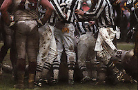 Referees clump together during the NFC Divisional Playoff game between the Green Bay Packers and the San Francisco 49ers at Lambeau Field on January 4, 1997, a game which became known as the Mud Bowl.