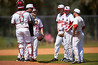 Illinois State Redbirds head coach Bo Durkac makes a pitching change as Jean Ramirez (27), Mitch Vogrin (20), Ryan Hutchinson (38), Owen Miller (8), and Joe Kelch (3) look on during a game against the Michigan State Spartans on March 8, 2016 at North Charlotte Regional Park in Port Charlotte, Florida.  Michigan State defeated Illinois State 15-0.  (Mike Janes/Four Seam Images)