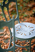 Detail of a painted metal garden chair
