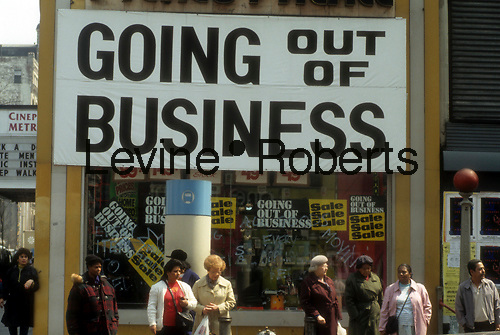 Retailer going out of business seen in Brooklyn, New York in 1992.  (© Frances M. Roberts)