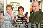 CALL US: Staff at the Kilcummin Rural Development Office who are hosting classes for older people on the use of mobile phones, l-r: Joan Mulchinock, Susan O'Connor, John Moriarty.
