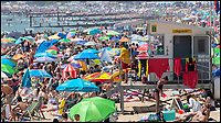 BNPS.co.uk (01202 558833)<br /> Pic: PhilYeomans/BNPS<br /> <br /> Saturday Scorcher - Every grain of sand was covered as the Saharan plume reached Bournemouth's holday beaches today sending the mercury soaring.