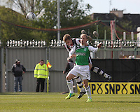 Marc McAusland beats Leigh Griffiths in the air in the St Mirren v Hibernian Clydesdale Bank Scottish Premier League match played at St Mirren Park, Paisley on 29.4.12.