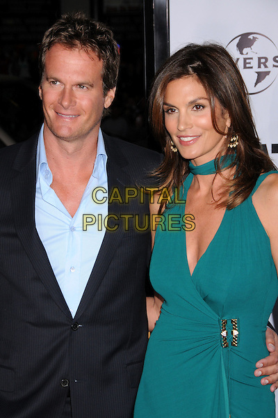 "RANDE GERBER & CINDY CRAWFORD.""Leatherheads"" Los Angeles Premiere at Grauman's Chinese Theatre, Hollywood, California, USA..March 31st, 2008.half length black suit green dress married husband wife randy.CAP/ADM/BP.©Byron Purvis/AdMedia/Capital Pictures."