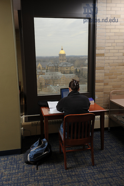 MDiv student Christina Bax studies in the grad student lounge on the 10th floor of Hesburgh Library
