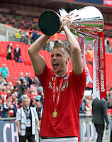 Marc Roberts of Barnsley with the trophy after winning the Johnstone's Paint Trophy Final match between Oxford United and Barnsley at Wembley Stadium, London, England on 3 April 2016. Photo by Alan  Stanford / PRiME Media Images.