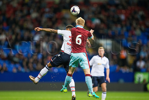 26.07.2016. Macron Stadium, Bolton, England. Pre Season Football Friendly. Bolton Wanderers versus Burnley. Bolton Wanderers forward Kaiyne Woolery and Burnley FC defender Ben Mee jump for the ball.