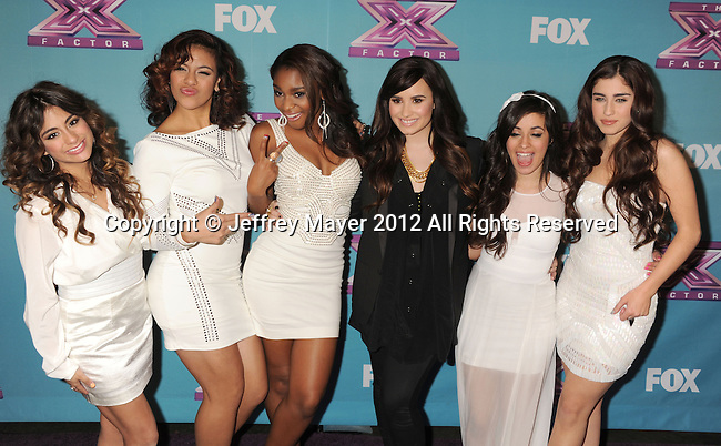 LOS ANGELES, CA - DECEMBER 19: Demi Lovato and Fifth Harmony arrive at Fox's 'The X Factor' Season Finale Night 1 at CBS Televison City on December 19, 2012 in Los Angeles, California.