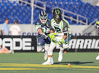 Annapolis, MD - July 7, 2018: New York Lizards Kevin McNally (72) and Chesapeake Bayhawks Stephen Kelly (24) fights for the ground ball during the game between New York Lizards and Chesapeake Bayhawks at Navy-Marine Corps Memorial Stadium in Annapolis, MD.   (Photo by Elliott Brown/Media Images International)