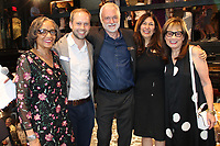 NWA Democrat-Gazette/CARIN SCHOPPMEYER Carolyn Allen (from left); Martin Miller, TheatreSquared executive director; Bob Ford, creative director and Amy Herzberg, associate artistic director; and Judy Schwab, board member, celebrate the opening of the theater company's season and new building Aug. 8 in Fayetteville.