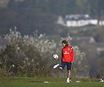 Scotland striker Stevie May amuses himself with a ball on the banks of the River Clyde