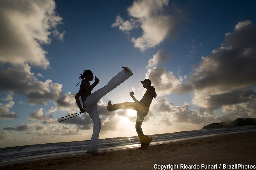 "Capoeira, a Brazilian martial art that combines elements of dance, acrobatics and music, and is usually referred to as a game - known for quick and complex moves, using mainly power, speed, and leverage for a wide variety of kicks, spins, and highly mobile techniques - On 26 November 2014 capoeira was granted a special protected status as ""intangible cultural heritage"" by UNESCO. Ponta Negra beach, Natal city, Rio Grande do Norte State, Brazil."