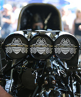 Feb. 14, 2013; Pomona, CA, USA; Detailed view of the injectors on the car of NHRA funny car driver Alexis DeJoria during qualifying for the Winternationals at Auto Club Raceway at Pomona.. Mandatory Credit: Mark J. Rebilas-