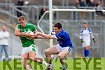 Shane Brosnan Kerins O'Rahillys tackles  Legions Tom Moriarty during their County Championship quarter final in Fitzgerald Stadium on Saturday