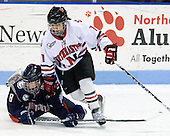 Brittany Murphy (UConn - 8), Rachel Llanes (NU - 11) - The University of Connecticut Huskies defeated the Northeastern University Huskies 4-1 in Hockey East quarterfinal play on Saturday, February 27, 2010, at Matthews Arena in Boston, Massachusetts.