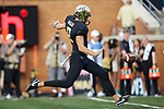 Dom Maggio (8) of the Wake Forest Demon Deacons punts the football during second half action against the Clemson Tigers at BB&T Field on October 6, 2018 in Winston-Salem, North Carolina. the Tigers defeated the Demon Deacons 63-3. (Brian Westerholt/Sports On Film)