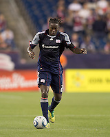 New England Revolution midfielder Shalrie Joseph (21) brings the ball forward. In a Major League Soccer (MLS) match, the New England Revolution tied Toronto FC, 0-0, at Gillette Stadium on June 15, 2011.