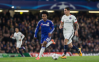 Angel Di Maria of Paris Saint-Germain under pressure from Willian of Chelsea during the UEFA Champions League Round of 16 2nd leg match between Chelsea and PSG at Stamford Bridge, London, England on 9 March 2016. Photo by Andy Rowland.