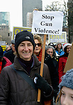 "This women was among hundreds of Seattle residents who marched from Westlake Center Park to the Seattle Center on January 13, 2013, calling for stricter regulations of firearms. Sponsored by a network of churches and other groups called ""Stand-up Washington,"" the demonstrators called for a state ban on semi-automatic weapons as well as stricter gun laws."