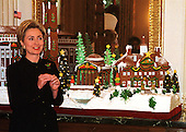 """First Lady Hillary Rodham Clinton announced the 1999 White House holiday theme """"Holiday Treasures at the White House"""" at the White House in Washington, D.C. on December 6, 1999.  The traditional Gingerbread creation, located in the State Dining Room, is a confectionery tribute to some of the historic treasures around our nation's capitol.  White House pastry chefs created this delicious masterpiece to take us back to 19th century Washington, surrounded by four timeless landmarks at Christmas time: The White House, the Jefferson Memorial, the Washington Monument, and Mount Vernon.  The spectacular creation would not be complete without its marzipan Potomac River and the chocolate trees that line its banks.  .Credit: Ron Sachs / CNP"""