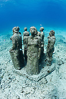 RG40558-D. underwater sculpture garden called The Silent Evolution, made by artist Jason de Caires Taylor. Part of the Museo Subacuatico de Arte, these cement sculptures number in the hundreds and rest in 25 feet of water off Isla Mujeres and depict real people, including many locals from the Cancun area. Made using special materials which encourage colonization by coral and other invertebrate marine life, and also attract tropical fish species. One goal of this installation is to help form an artificial reef which will reduce tourist pressure on nearby natural reefs.  Mexico, Gulf of Mexico, Caribbean Sea.<br />