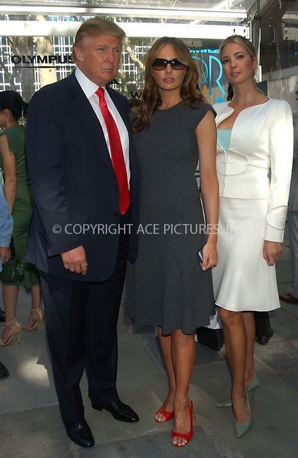 WWW.ACEPIXS.COM . . . . . ....September 11, 2006, New York City. ....Donald Trump with wife Melania Knauss and daughter Ivanka attend the Oscar de La Renta fashion show held at Bryant Park.....Please byline: KRISTIN CALLAHAN - ACEPIXS.COM.. . . . . . ..Ace Pictures, Inc:  ..(212) 243-8787 or (646) 769 0430..e-mail: info@acepixs.com..web: http://www.acepixs.com