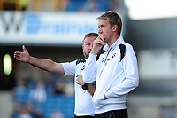 Billy Reid,(left)  assistant manager for Swansea and Graham Potter (right)  Manager of Swansea City in discussion during the Sky Bet Championship match between Millwall and Swansea City at The Den in London, England. September 1, 2018