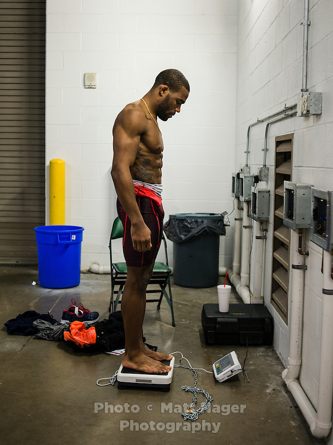 Olympic Gold champion wrestler Jordan Burroughs (cq), checks his weight before his official weigh-in and body check before the Pan American Championships at Dr. Pepper Arena in Frisco, Texas, Friday, February 26, 2015. Burroughs went on to win Gold at the event. <br /> <br /> Photo by Matt Nager