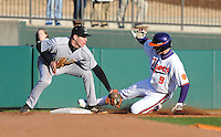 Steven Duggar (9) of the Clemson Tigers is out trying to steal third base with Eric Brenk (33) defending in the fifth inning of a game on Wednesday, March 6, 2013, at Doug Kingsmore Stadium in Clemson, South Carolina. Clemson won, 9-2. (Tom Priddy/Four Seam Images)