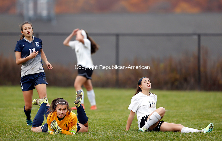 Beacon Falls, CT- 09 November 2016-110916CM03-  Woodland's, Samantha Plasky right, and Immaculate keeper, Kristen Rossler watch as the ball misses the net during their state tournament matchup in Beacon Falls on Wednesday. Also in the play is Immaculate's (11). Woodland would be knocked out of the tournament, after losing 2-1.       Christopher Massa Republican-American