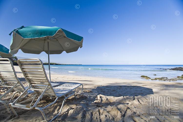 Lawn chairs and umbrellas on Mauna Kea Beach on the Big Island of Hawaii