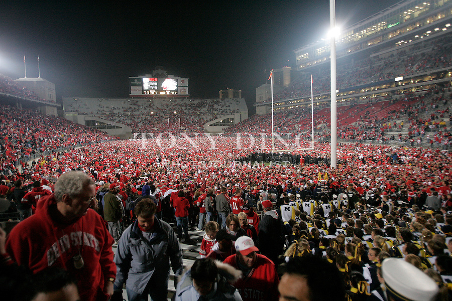 18 Nov 2006: Buckeyes fans storm the field after Ohio State's 42-39 win over Michigan in a college football game at Ohio Stadium in Columbus, OH.