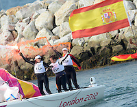 11.08.2012. Weymouth, Dorset, England.  Members of The Spanish team Celebrate After Winning in Elliott 6m  Competition of sailing Event London 2012 Olympic Games The Spanish team Won Gold Medal