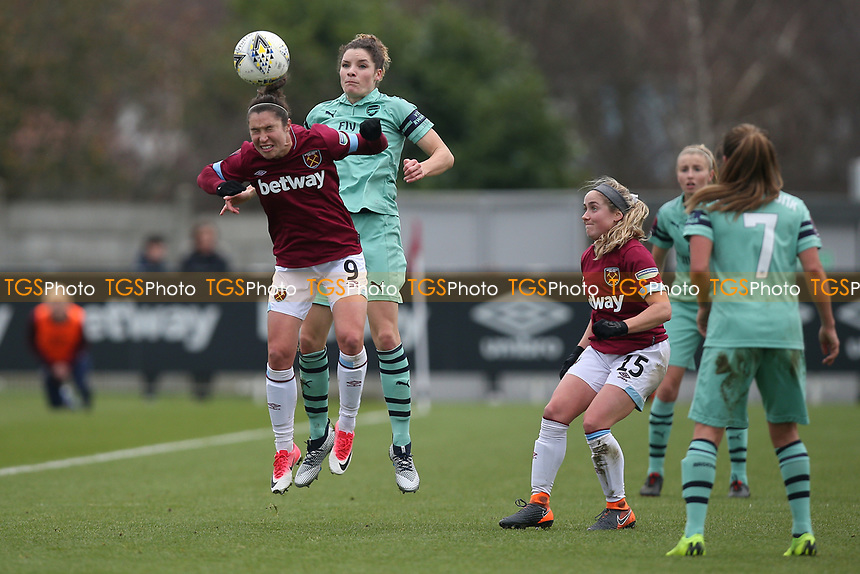 Vivianne Miedema of Arsenal and Jane Ross of West Ham during West Ham United Women vs Arsenal Women, FA Women's Super League Football at Rush Green Stadium on 6th January 2019