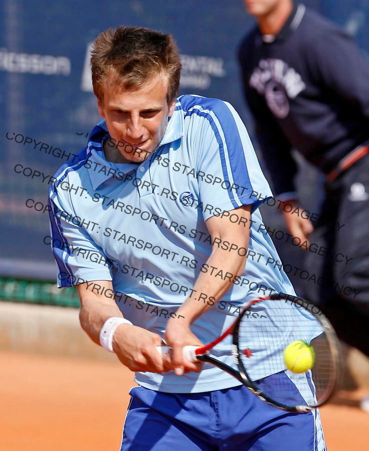 "Mirza Basic from Bosnia returns the ball during ATP 250 series tennis tournament ""Serbia Open"" in Belgrade, Serbia, Saturday, April 23. 2011. (credit image & photo: Pedja Milosavljevic / thepedja@gmail.com / +381641260959)"