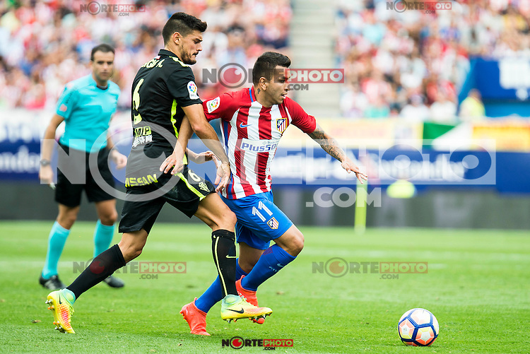 Atletico de Madrid's player Ángel Martín Correa and Sporting de Gijon's Sergio A. during a match of La Liga Santander at Vicente Calderon Stadium in Madrid. September 17, Spain. 2016. (ALTERPHOTOS/BorjaB.Hojas) /NORTEPHOTO