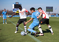 Schillo Tshuma (23) and Mikey Ambrose (5) of Maryland try to take the ball away from Danny Garcia (17) of North Carolina during the game at the Maryland SoccerPlex in Germantown, MD. Maryland defeated North Carolina, 2-1,  to win the ACC men's soccer tournament.